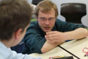 A teacher during a lesson with his student
