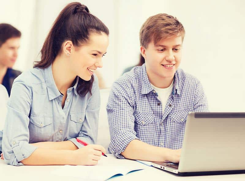 a teacher and his student working together on a computer