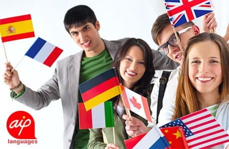 Students who hold different flags from all the world